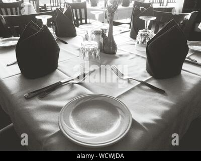 Place Settings In Restaurant - Stock Photo