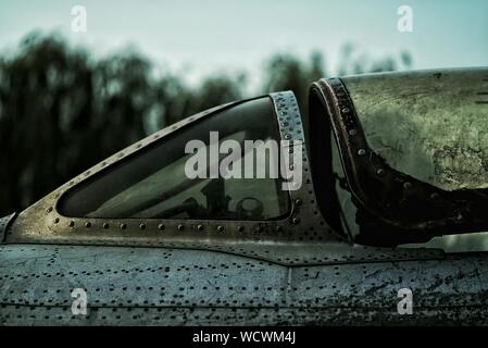 Old Fighter Plane Against Sky - Stock Photo