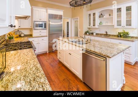 Beautiful Custom Kitchen Interior With Hard Wood Floors. - Stock Photo