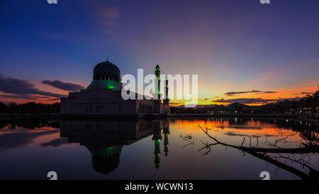 Kota Kinabalu City Mosquewith Reflection On Lake At Sunset - Stock Photo