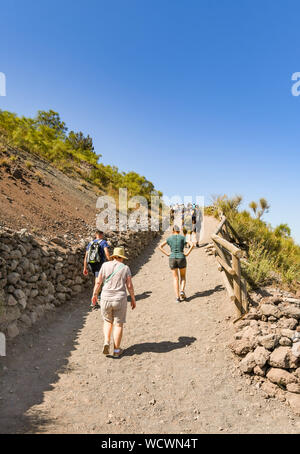 NAPLES, ITALY - AUGUST 2019: People walking up the path to the crater of Mount Vesuvius on the outskirts of Naples. - Stock Photo