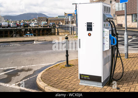 Electric car charging point on a harbourside street on a sunny summer day