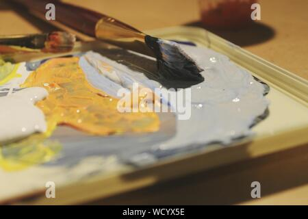 Close-up Of Paintbrush On Palette - Stock Photo