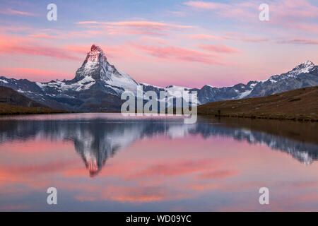 Scenic View Of Lake And Mountains Against Sky During Sunset - Stock Photo