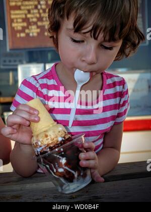 Close-up Of Girl Holding Icecream Cone