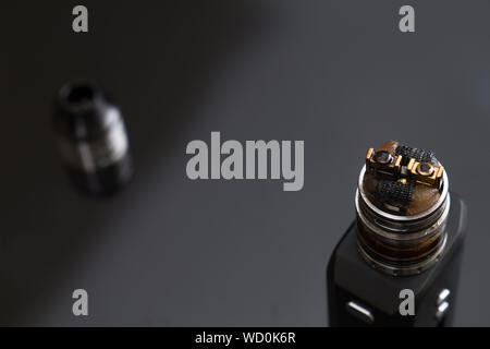 Close-up Of Electronic Cigarette On Black Background - Stock Photo
