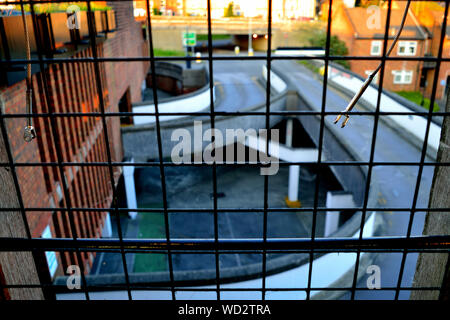 High Angle View Of Elevated Road At Parking Garage Seen From Metal Grate - Stock Photo