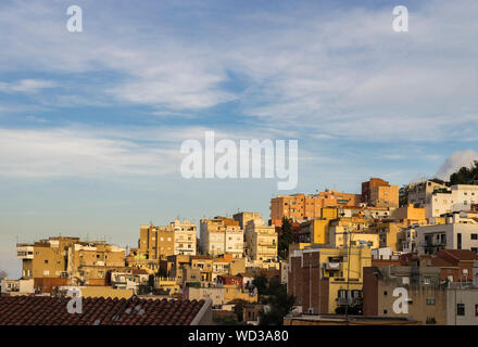 The view of the buildings on the hilly suburban area of Barcelona in Catalonia region of Spain during late afternoon in autumn season - Stock Photo
