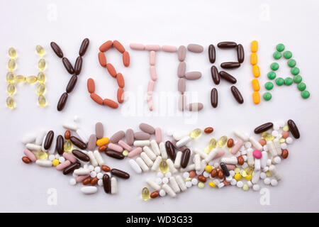 Conceptual Hand writing text caption inspiration Medical care Health concept written with pills drugs capsule word HYSTERIA season On white isolated b - Stock Photo