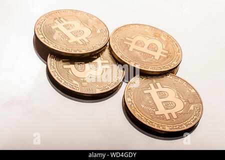 Close-up Of Bitcoins On Table - Stock Photo