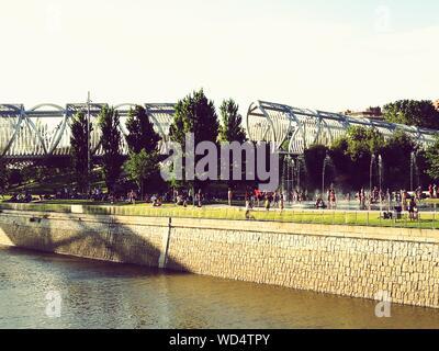 People At Madrid Rio By Manzanares River - Stock Photo
