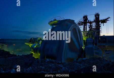 Bucket-wheel Excavator At Open-pit Mine Against Sky At Dusk - Stock Photo