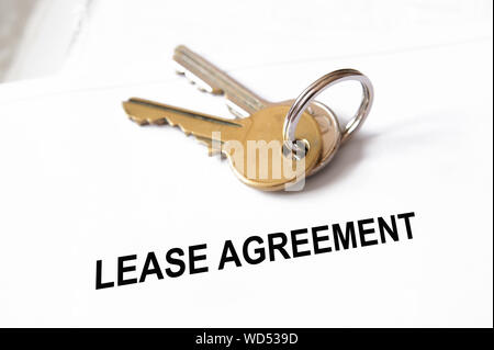 High Angle View Of Lease Agreement Text On Paper And Keys - Stock Photo