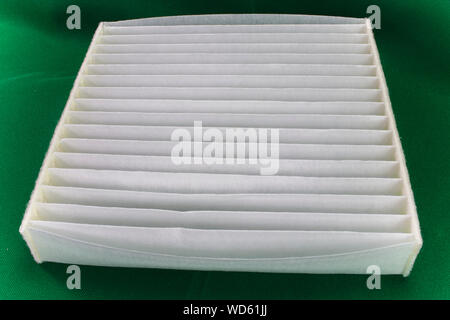 Air filter for a car on green  background. Car filter close up.  High resolution image gallery. - Stock Photo