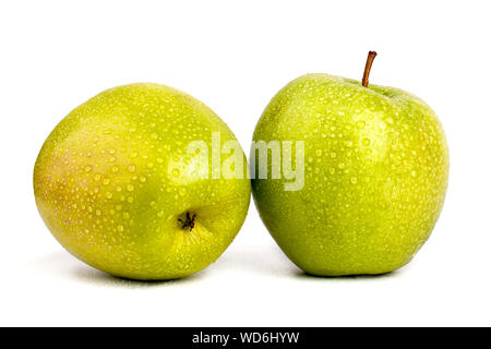 Two juicy green apples in drops of water on white background isolated close up macro - Stock Photo