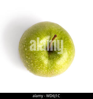 Green apple in water drops on white background isolated close up macro top view - Stock Photo