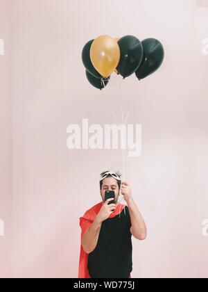 Portrait Of Young Man With Balloons - Stock Photo