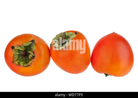 Three whole persimmon orange fruit with green leaves on white background isolated close up, top view, side view, rear view - Stock Photo