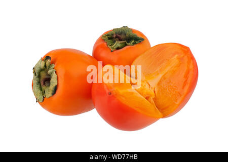 Two whole orange persimmons fruits or diospyros kaki and one persimmon sliced in half with green leaves on white background isolated close up - Stock Photo