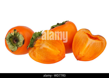 Two orange persimmons fruits or diospyros kaki and two halves of one persimmon with green leaves on white background isolated close up - Stock Photo