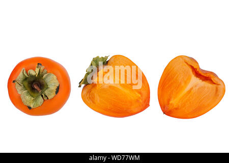 Persimmon or sharon fruit with green leaves one whole and one cut in two halves on white background isolated close up - Stock Photo