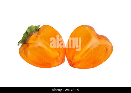 Persimmon orange fruit with green leaves sliced in two halves on white background isolated close up - Stock Photo