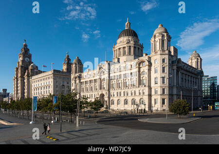 The Three Graces at Pier Head in Liverpool - Stock Photo
