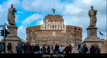 Rome, Italy - March 2, 2017: Castel Sant'angelo and Bernini's statue on the bridge, Rome, Italy. Palace of justice on the background. - Stock Photo