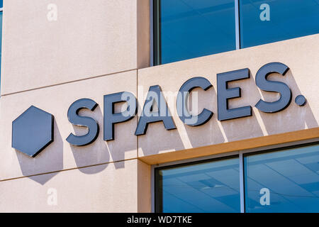 August 7, 2019 San Jose / CA / USA - Spaces sign at their office building located in Silicon Valley; Spaces is an American company that provides share - Stock Photo