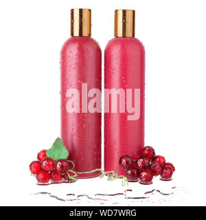 Two red plastic shampoo and hair conditioner bottles shower gel and lotion in water drops template white background isolated closeup, decorative grape - Stock Photo