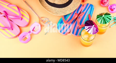 Vacation on the beach concept with colorful summer cocktails and beach accessories - hat, flip flops, sun glasses - Stock Photo
