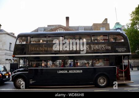 a routemaster bus painted black full of tourists on the ghost bus tours london tour uk - Stock Photo