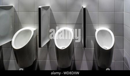 Close-up Of Urinals In Restroom - Stock Photo