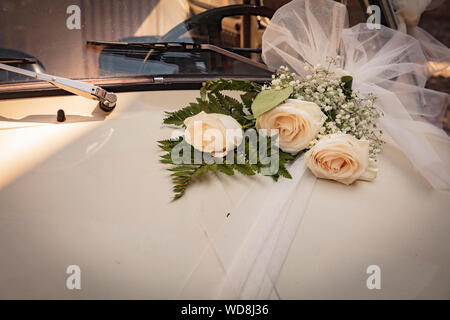 Malcesine, Lake Garda, Italy, August 2019, some wedding flowers on a Fiat 500 bonnet - Stock Photo