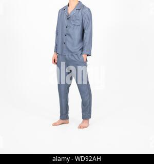 An isolated shot of a person wearing blue pajamas - Stock Photo