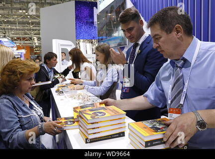 Moscow, Russia. 29th Aug, 2019. MOSCOW, RUSSIA - AUGUST 29, 2019: People attend the City of Education Moscow International Forum at VDNKh. Alexander Shcherbak/TASS Credit: ITAR-TASS News Agency/Alamy Live News - Stock Photo