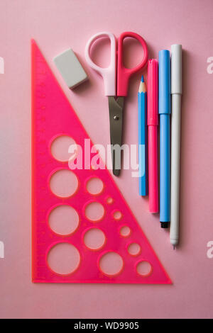 Various stationery on a trendy pink background. Back to school concept. Flat lay. - Stock Photo