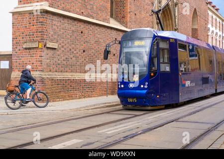 A modern tram on Ostrow Tumski, Wroclaw, Poland. - Stock Photo
