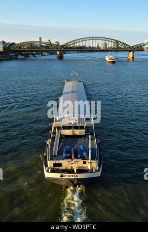 Tour boat on River Rhine and Hohenzollern Bridge - Stock Photo