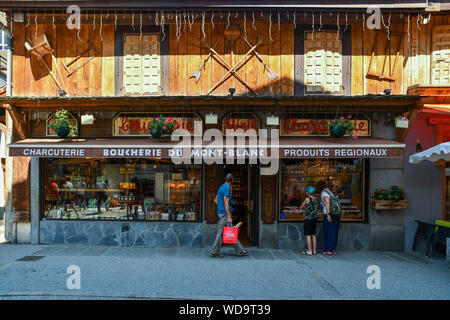 The typical wooden facade of a deli and butcher shop that sells local food in the historical centre of Chamonix-Mont-Blanc, Haute Savoie, France - Stock Photo