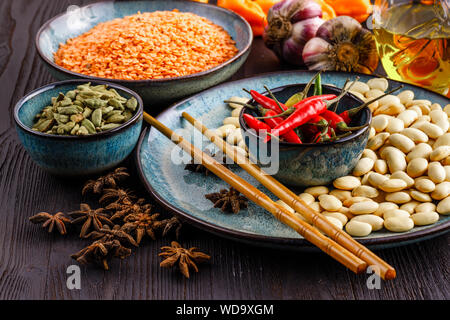 Bowl with red lentils on table - Stock Photo