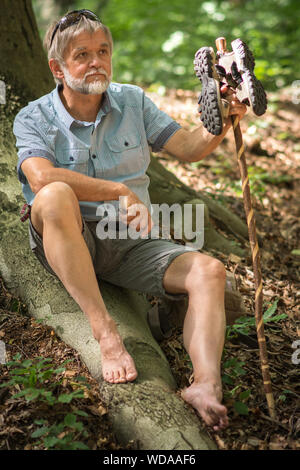 Man wanders and takes a break - Stock Photo