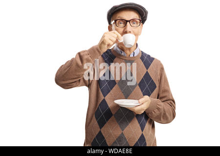 Elderly man taking a sip of espresso coffee isolated on white background - Stock Photo