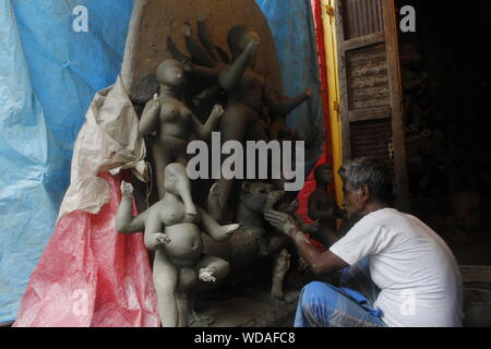 Kolkata, India. 25th Aug, 2019. Highly skilled idol makers of Kumartuli (Famous for Idol Making) are busy for crafting theme-based idols which will increase the grandeur of the upcoming Durga Puja in the month of October this year. (Photo by Sunam Banerjee/Pacific Press) Credit: Pacific Press Agency/Alamy Live News - Stock Photo