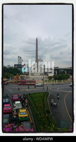 Victory Monument Against Vehicles On Street - Stock Photo