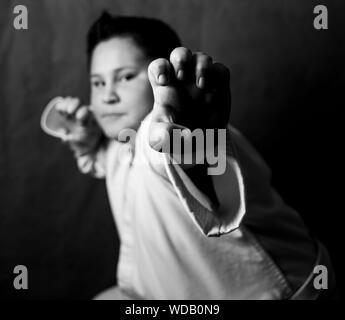 Portrait Of Boy Doing Martial Arts - Stock Photo