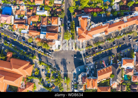 Top down view of a crowded road intersection in the Sanur area of the Denpasar city in Bali, Indonesia - Stock Photo