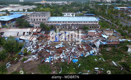 Danzhou. 29th Aug, 2019. Photo taken on Aug. 29, 2019 shows the damaged factory building after a tornado ripped across Nada Township of Danzhou City, south China's Hainan Province. At least eight people died and one was seriously injured as a tornado lashed a township in China's southernmost island province of Hainan early Thursday morning, local authorities said. Credit: Guo Cheng/Xinhua/Alamy Live News - Stock Photo