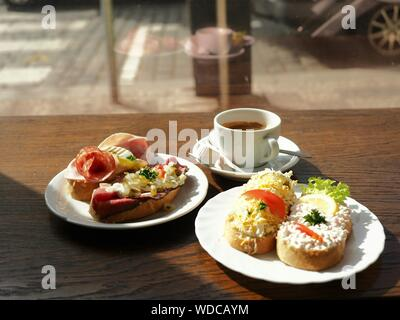 High Angle View Of Open Sandwiches On Plate With Espresso Coffee Cup On Table - Stock Photo