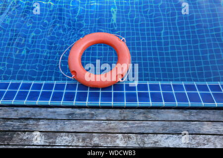 High Angle View Of Life Belt Floating On Water In Swimming Pool - Stock Photo